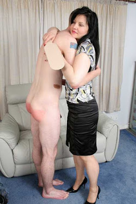 women hugging naked man, after spanking him with a paddle, aftercare, tlc