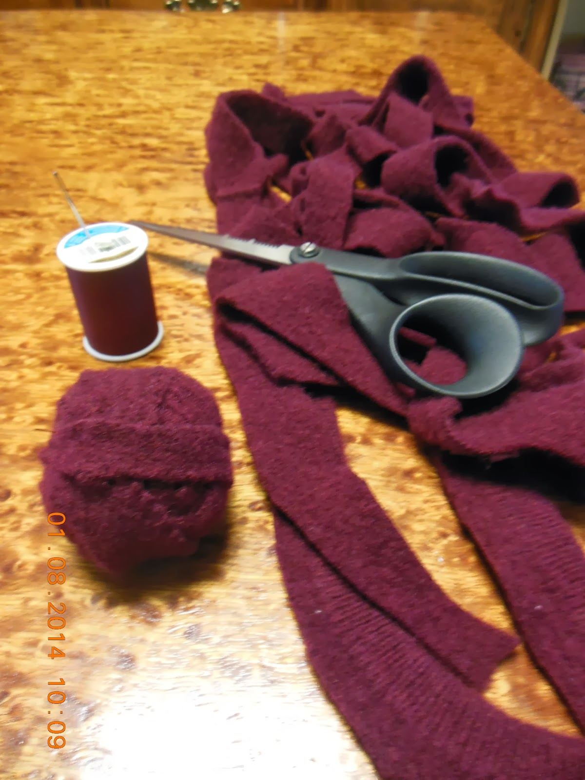 How to make woolen dryer balls, from a re-purposed sweater.