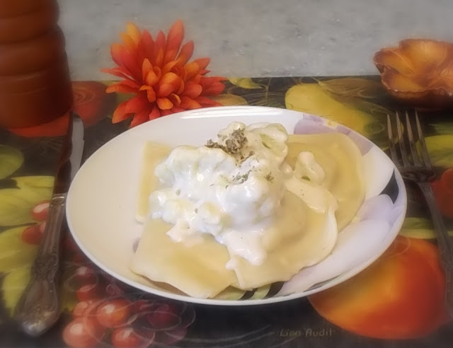 pierogies with bechamel sauce and cauliflower