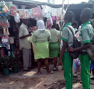 Photo: Shouldn't they be in class? Secondary students gather at a shop buying Valentine gifts