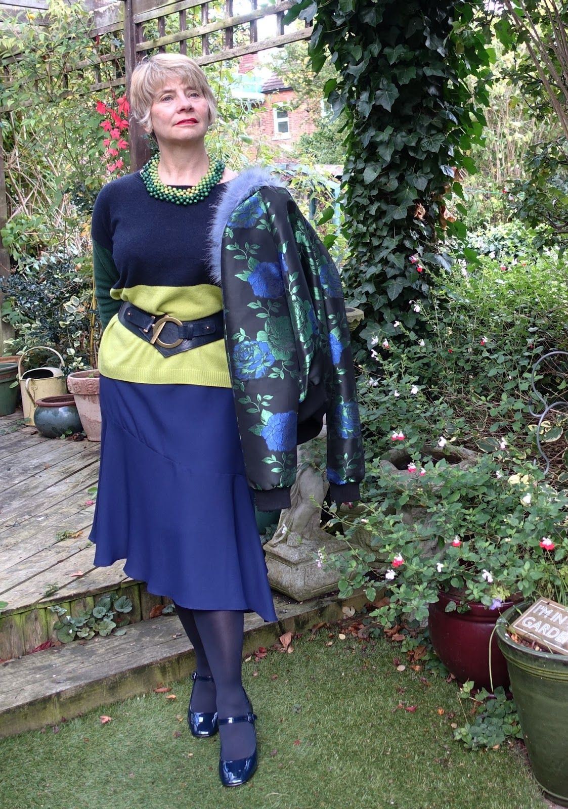 Image showing over 40 blogger Gail Hanlon in Hobbs Sofia jumper and asymmetric midi skirt with waist belt