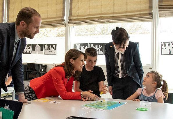 Princess Marie wore Alexander McQueen Flared-hem Crepe Jacket and the Princess carried Carlend Copenhagen clutch at Autism school