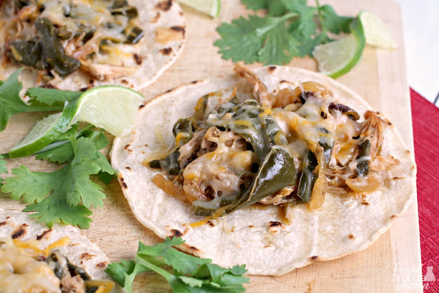 Tender, flavorful, and juicy, these Slow Cooker Chipotle Chicken & Poblano Street Tacos have a delicious smoky flavor with just a little kick of heat.