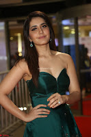 Raashi Khanna in Dark Green Sleeveless Strapless Deep neck Gown at 64th Jio Filmfare Awards South ~  Exclusive 066.JPG
