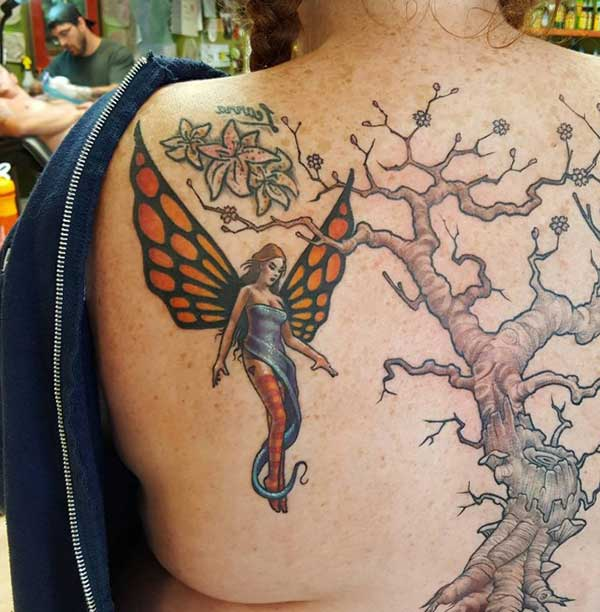 angel and tree tattoo