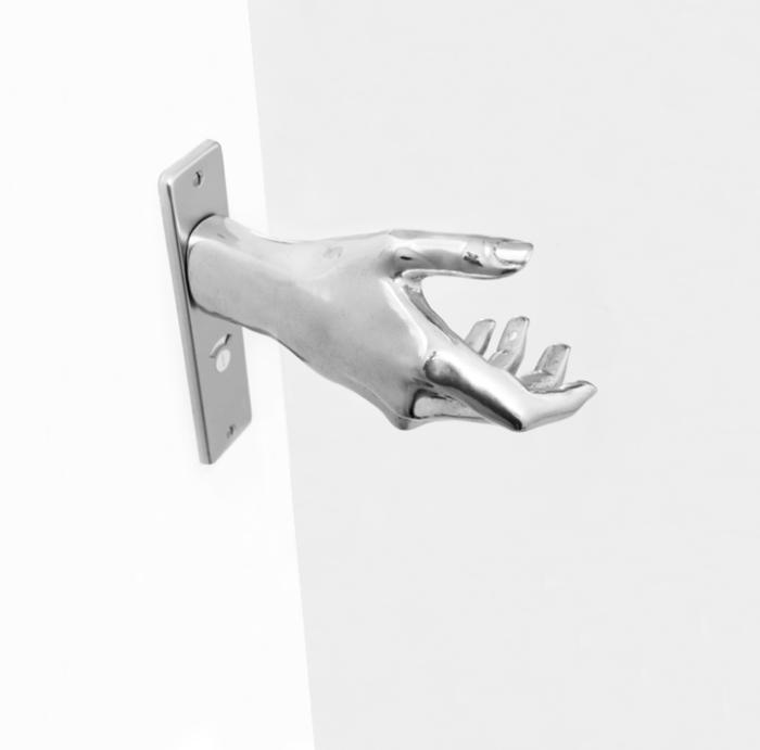 Naomi Thellier de Poncheville's Hand-Le Door Knob
