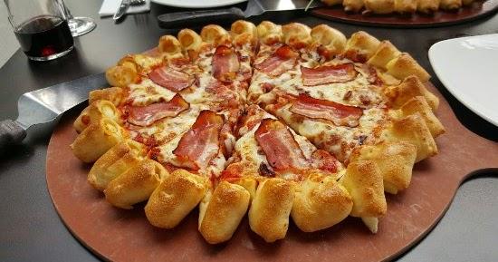PZZA Saham PZZA | Pizza Hut (PZZA) Kaji Ekspansi ke Area Stasiun