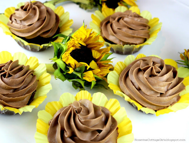 Summer Recipes #Chocolate Chocolate cupcakes with cream cheese whipped chocolate icing on a white backgrounds with sunflower on tray | rosevinecottagegirls.com