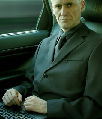 Image of a confident businessman in a power suit working on a pc in a taxi