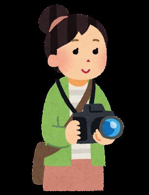 一眼レフカメラを持っている人のイラスト(女性)