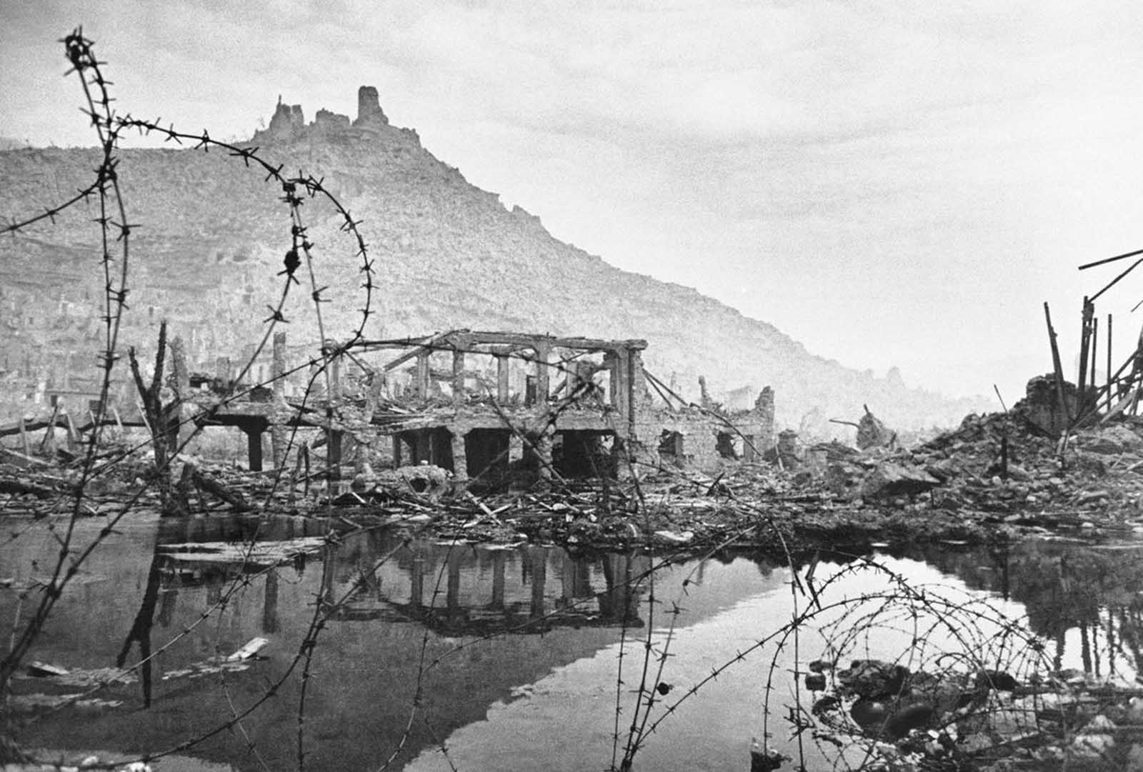 Desolation in the Italian city of Cassino in May of 1944, the day after the city's capture by the Allies. Hangman's Hill is shown in the background, scene of bitter fighting during the long and bitter siege of the stronghold.