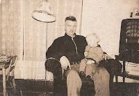 Emil Berger Olsen holding grandchild, Marquette