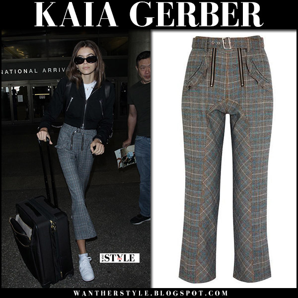 Kaia Gerber in grey plaid cropped trousers at LAX airport october 4 2017 model street style