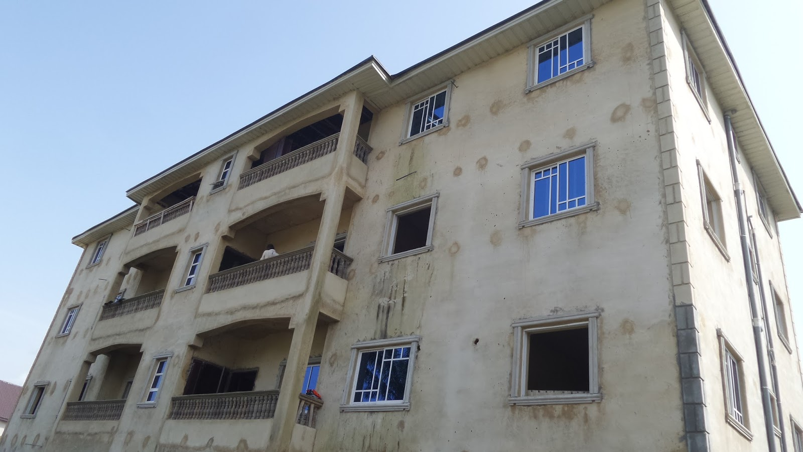 This are pictures from our home finish works at awkunanaw enugu we are hanging the metal doors fixing windows and other finish works