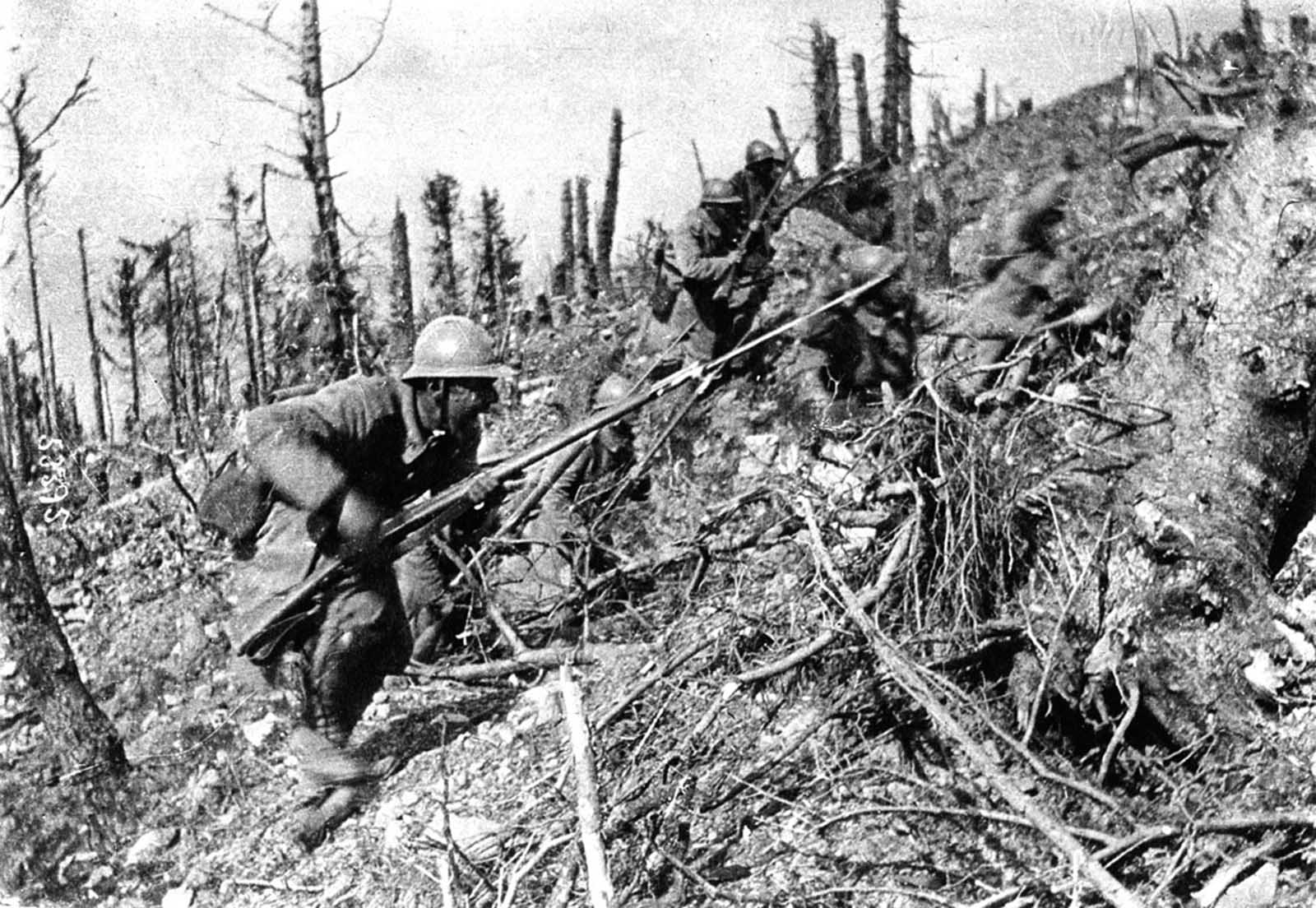 French soldiers in a bayonet charge, up a steep slope in the Argonne Forest in 1915. During the Second Battle of Champagne, 450,000 French soldiers advanced against a force of 220,000 Germans, momentarily gaining a small amount of territory, but losing it back to the Germans within weeks. Combined casualties came to more than 215,000 from this battle alone.