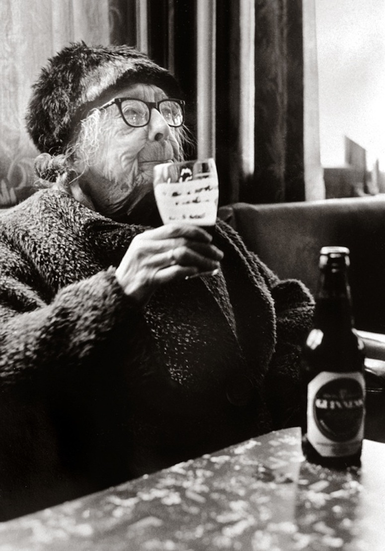 Gorgeous black and white photo of an old lady laughing and enjoying a beer at The Royal Oak, Bethnal Green. Best April Fool. MarchMatron.com