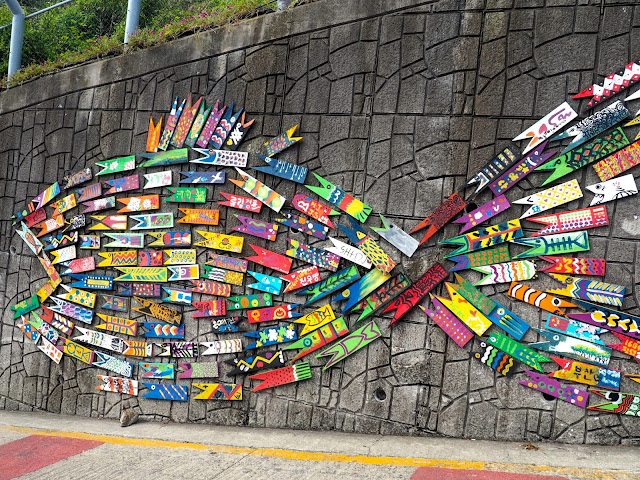 Large colourful fish made from small fish signs - art installation in Gamcheon Village, Busan, South Korea