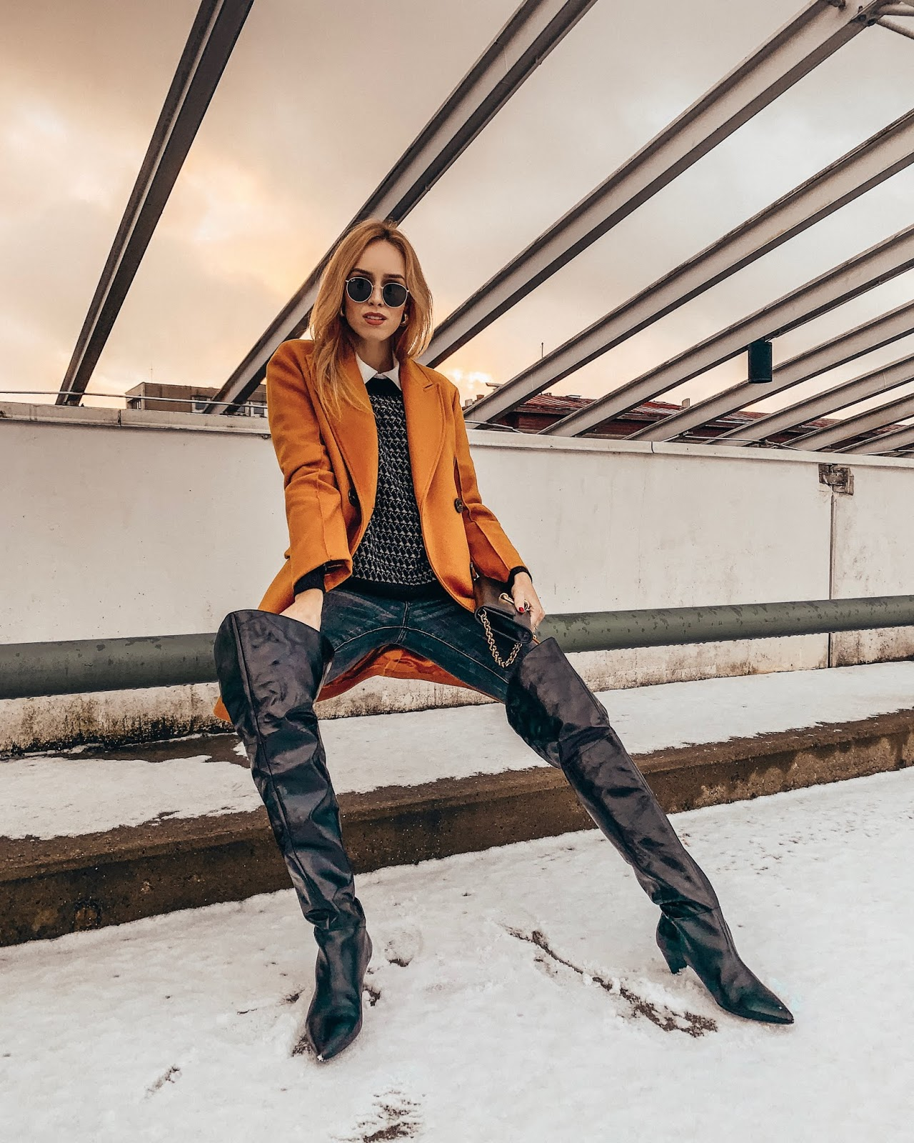 yellow wool coat over knee boots sweater jeans winter outfit