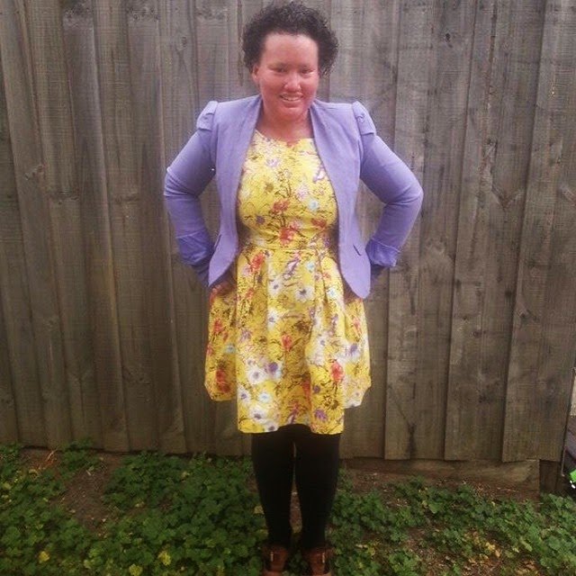 Carly Findlay yellow dress purple jacket