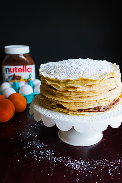 This Orange Cream and Nutella Crepe Cake looks and sounds divine!  Recipe over at mynameissnickerdoodle.com