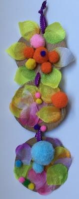 Spring window craft with pom poms