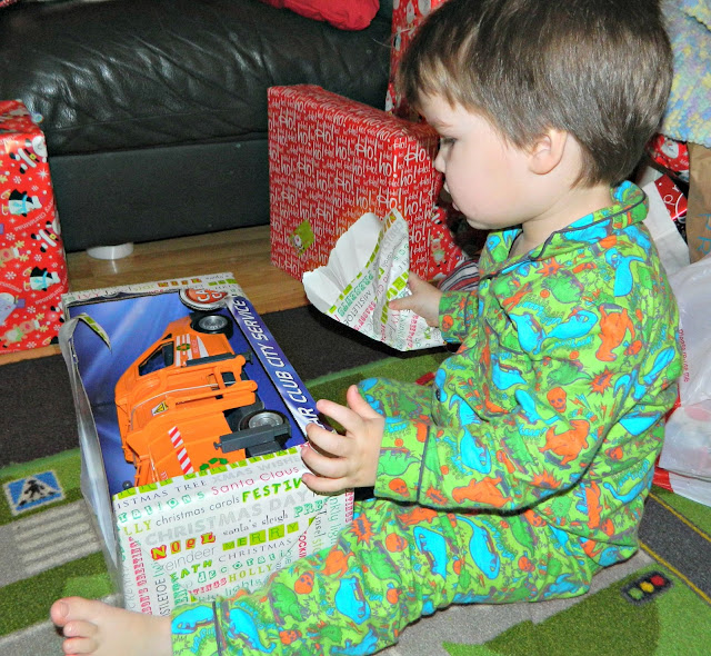 Christmas presents gifts unwrapping boy