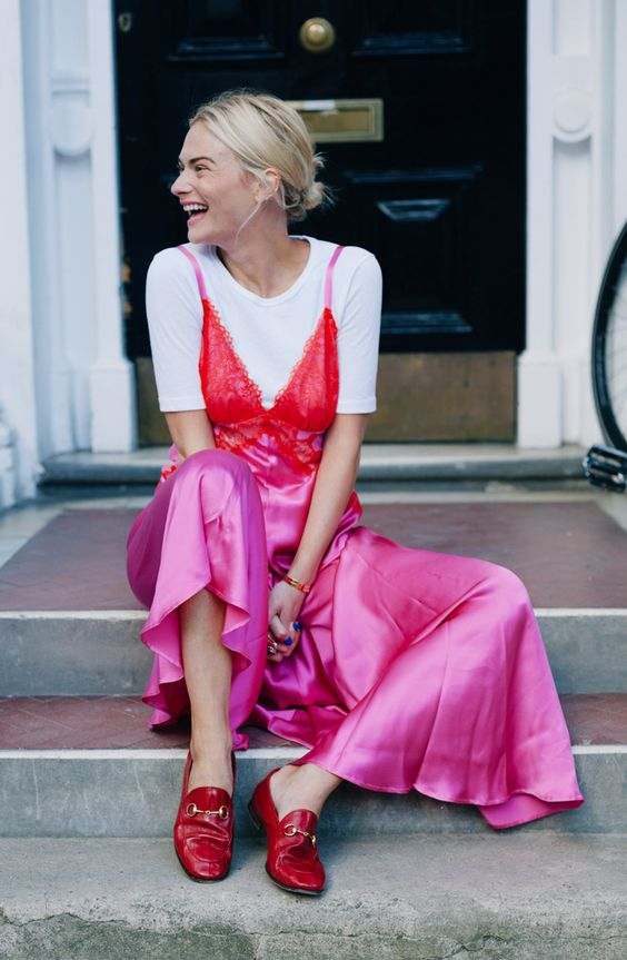 red lace and hot pink slip dress over white t shirt with red gucci loafers