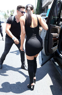Kim Kardashian shows off her butt