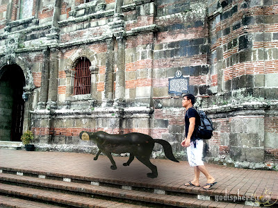 Dog with human head leading a man to enter church