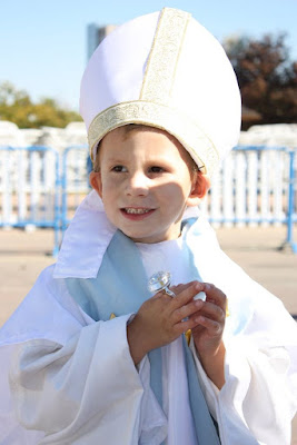 child dressed as pope