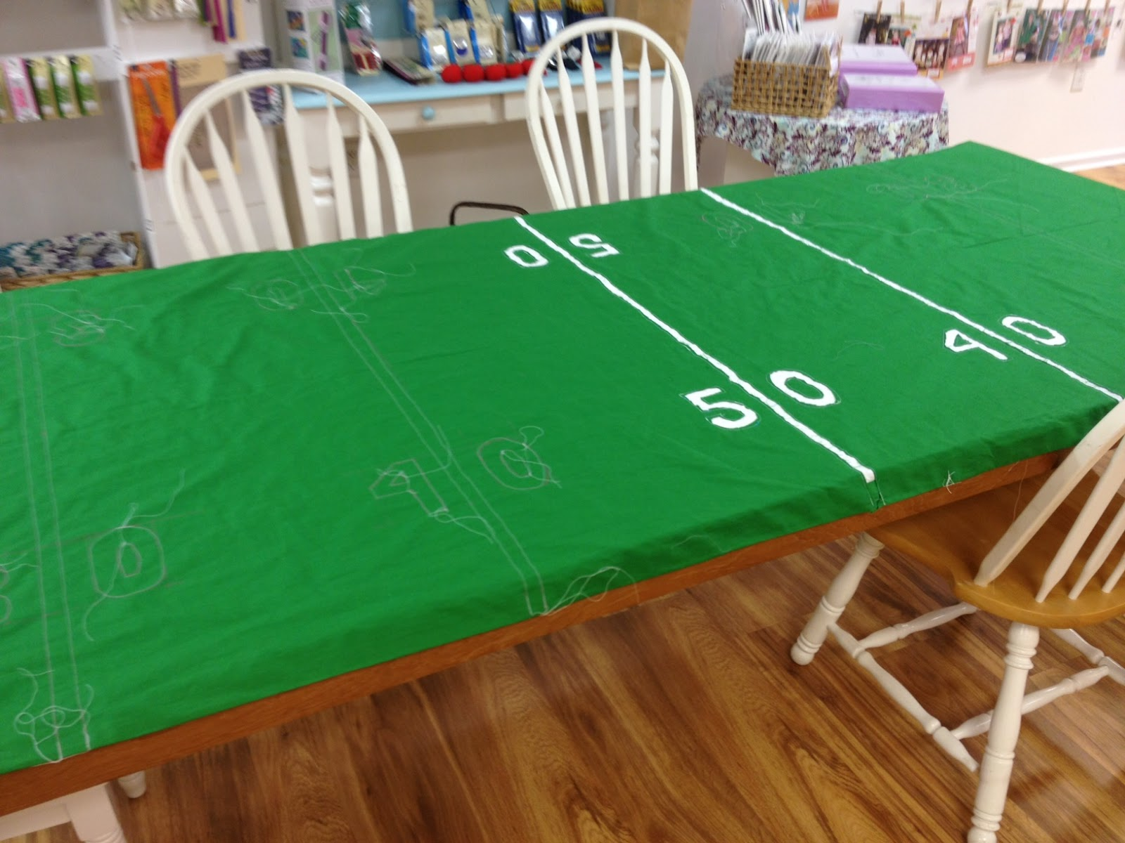 This green polyester table runner with white screen printed football field design would be perfect for your tailgating or football party decor. At this incredible price it could be disposable, but it's certainly reusable! 72