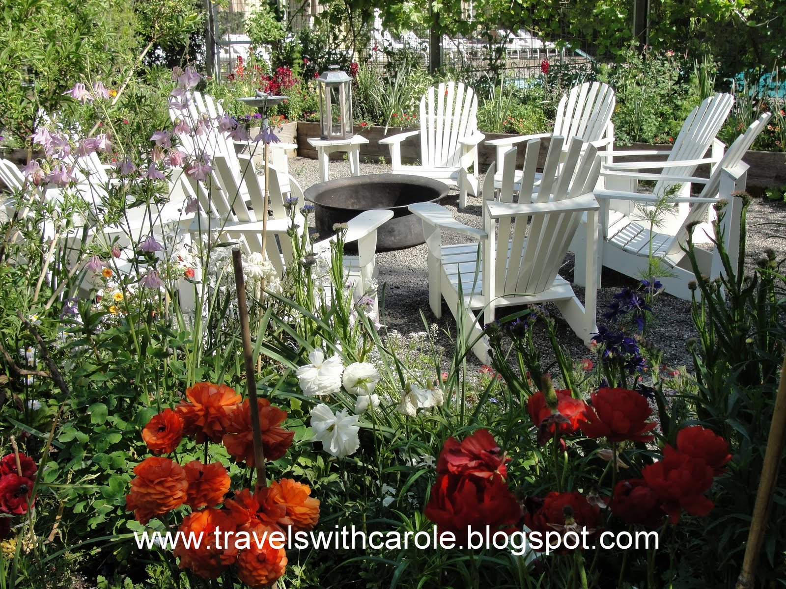 Adirondack chairs surround fire pit at The Farmhouse Inn ...