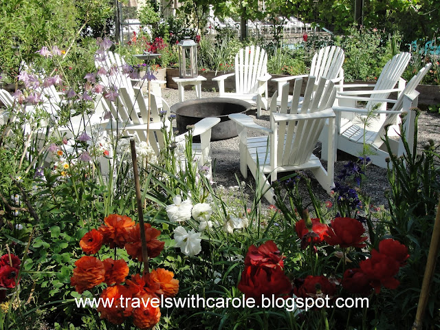 Adirondack chairs surround fire pit at The Farmhouse Inn in Forestville, California