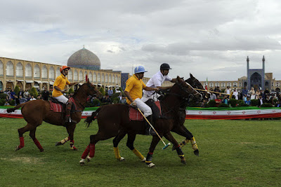 Two polo sport teams are competing in Naqshe jahan Square of Isfahan, Iran