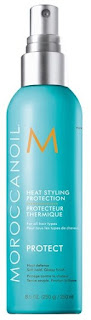 Click here to buy MOROCCANOIL HEAT STYLING PROTECTION SPRAY, one of the best for protecting natural hair during heat styling.