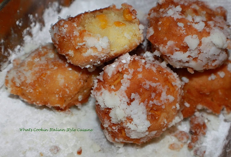 a little mini corn fritter that is like a donut with corn and rolled into powdered sugar. This is a Southern donut corn fritter