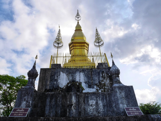 the golden pagoda on the peak of Mount Phousi in Luang Prabang, Laos
