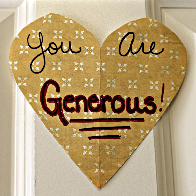 "A heart on a door with a handwritten note that says, ""you are generous."""