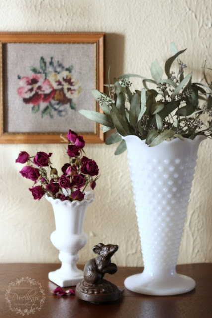 Dried roses and seeded eucalyptus vignette in the hallway.