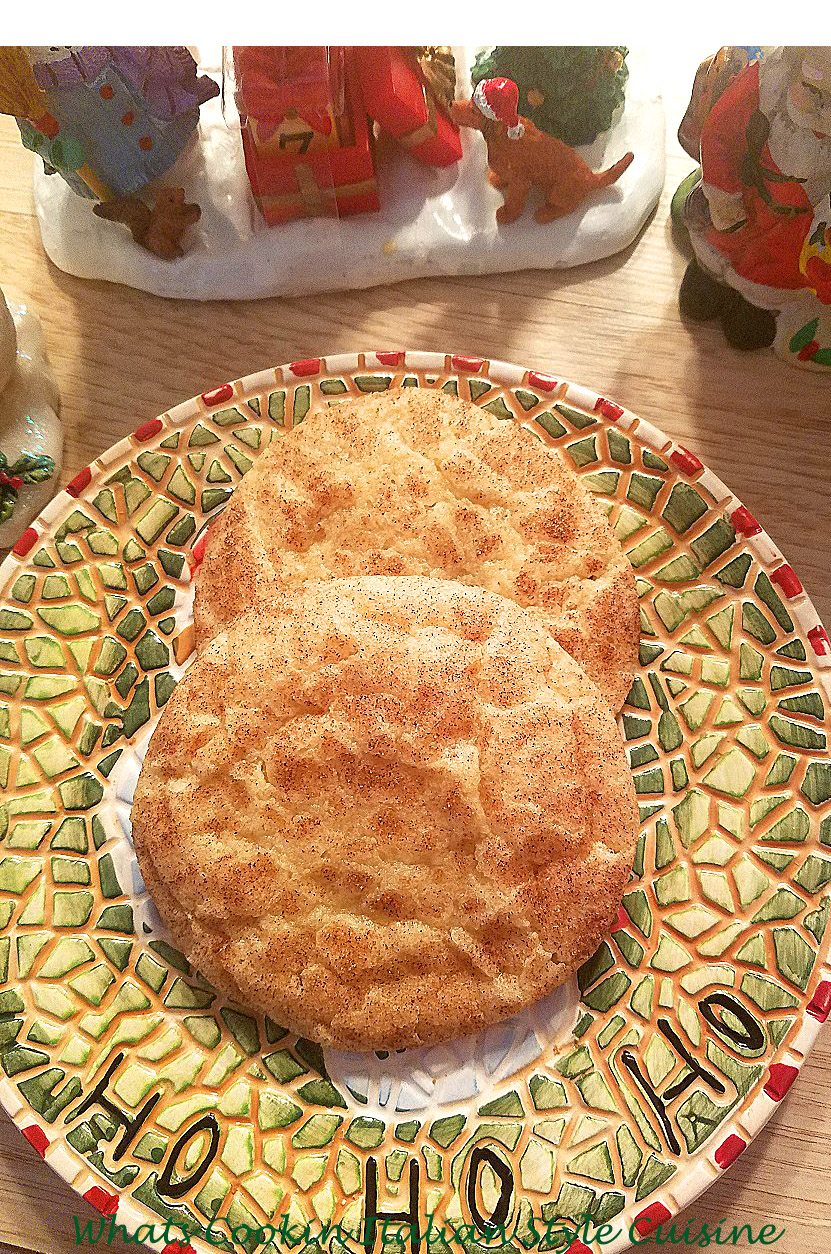 this is a cinnamon cookie called snickerdoodle cookies. A childhood favorite cinnamon and sugar cookie. Easy to make and pantry ingredients. Cinnamon and sugar cookies or snickerdoodles are a famous cookie known worldwide  these are a cinnamon sugar cookie with a delicious outer crispy cinnamon coating baked on. This is how to make the best ever snicker doodle cookies. These cookies are on a pretty Christmas plate that says ho ho ho and Christmas santa cookie decorations are in the background,