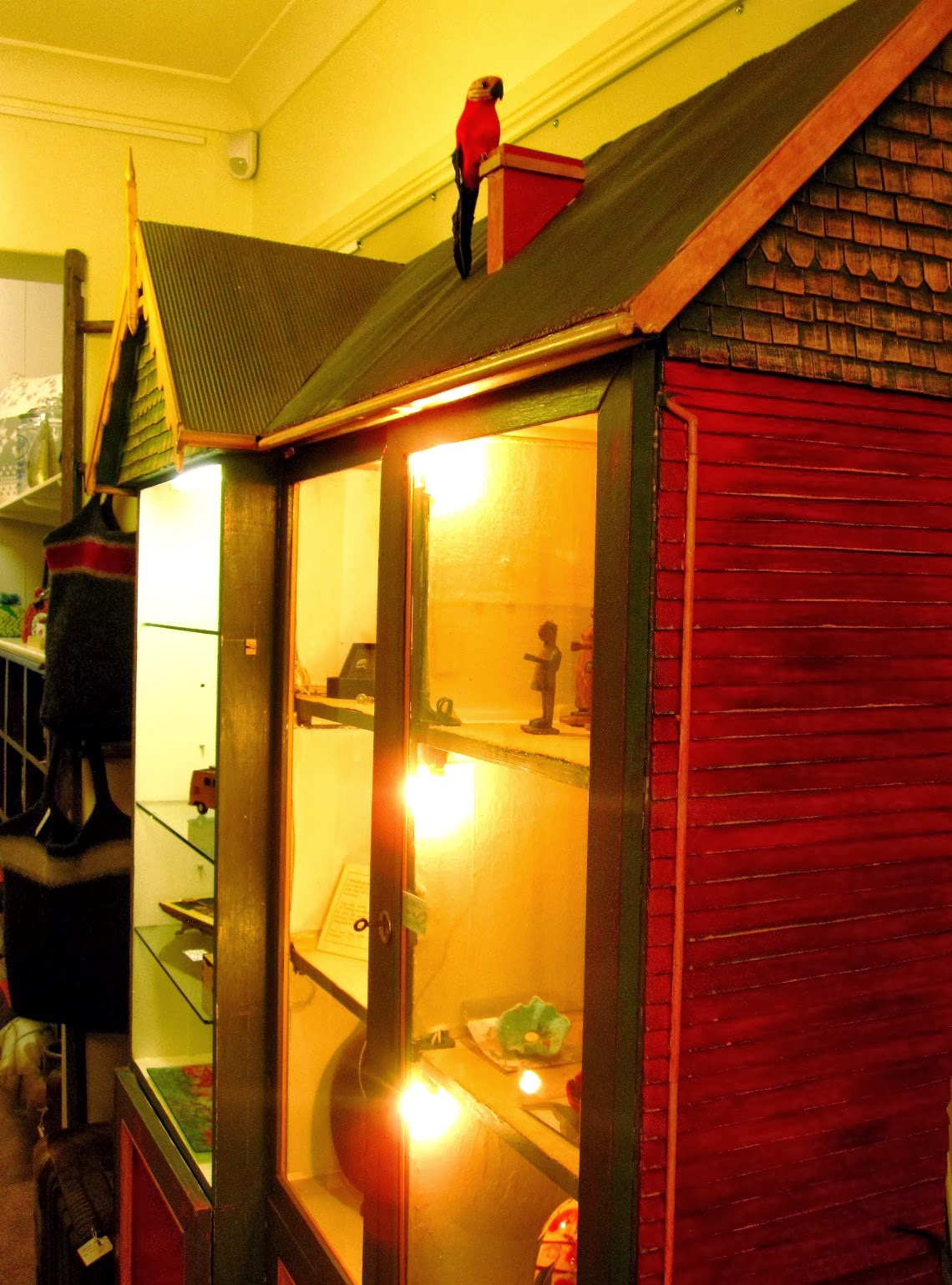 Display cabinet in the shape of a large dolls house