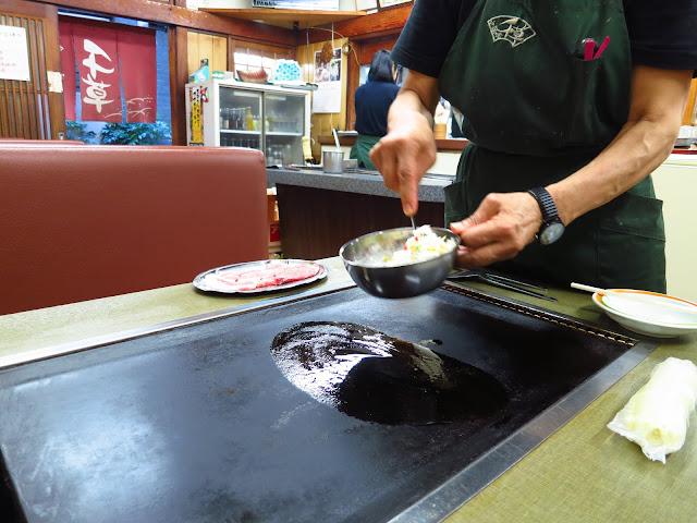 Okonomiyaki Japanese savory pancake restaurant. Osaka Tenjinbashisuji shopping street