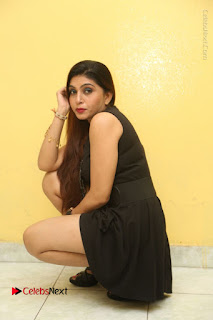 Tollywood Upcoming Actress Pooja Roshan Stills in Black Short Dress at Plus 1 Movie Trailer Launch  0245.JPG