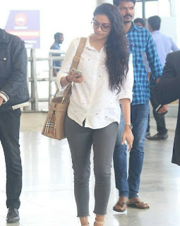 Keerthy Suresh in White Dress with Cute and Awesome Lovely Smile at Hyderabad Airport