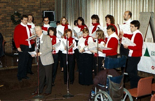 Stairwell Carollers sing for the 1989 Xmas exchange broadcast