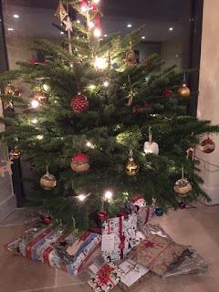 Christmas tree with presents around it