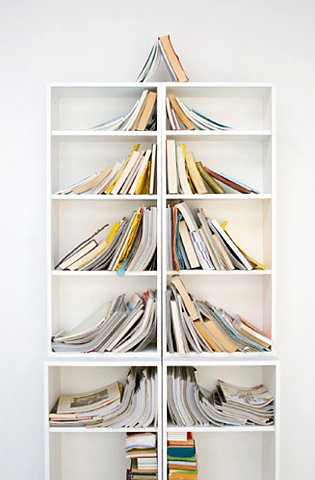 books on shelves arranged to look like a tree shape
