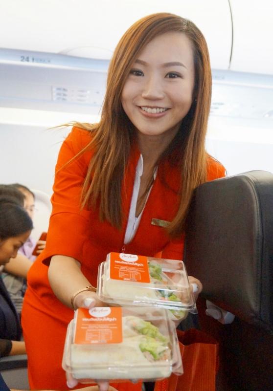 Y.E.S. 93.3FM DJs Peifen, our gorgeous flight attendant handing us our tuna tortilla!