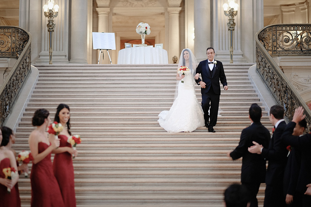 Father walking the daughter down the aisle in San Francisco City Hall Stairs