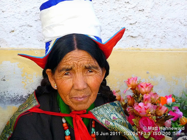 people, portrait, street portrait, headshot, Leh, Northern India, Ladakh, old Ladakhi woman, traditional Ladakhi hat, traditional Ladakhi costume, silk apron, goncha, Facing the World, © Matt Hahnewald
